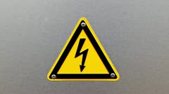 High voltage sign on a metal background Stock Footage