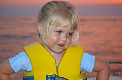 Young girl wearing a life jacket Stock Photos