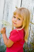 little girl with Queen Anne's Lace - stock photo