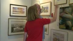 Analyzing and choosing art (3 of 3) Stock Footage