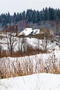 snow covered village - stock photo