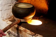 Stock Photo of russian oven and old cast-iron pot