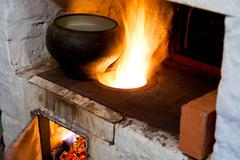 Russian stove and old cast-iron pot Stock Photos