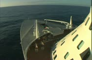 The bow of the Queen Mary 2 ocean liner sailing west at sunset Stock Footage