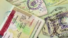 International passports with visas (USA, Egypt, Thailand and Shengen visas) Stock Footage