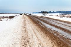 slippery country road - stock photo