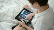 Sliding program icons on iPad new device screen Stock Footage