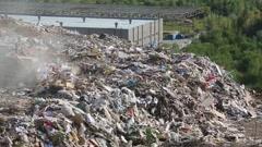 Stock Video Footage of Bulldozer on landfill