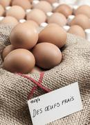 Baskets of eggs Stock Photos