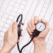 Blood pressure gauge in the hands Stock Photos