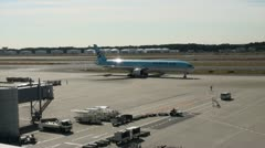 Korean Air plane turns while JAL airplane takes off from Narita Airport Stock Footage