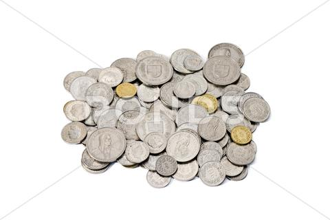 Stock photo of Pile of dirty swiss franc and rappen coins