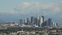 Stock Video Footage of Downtown Los Angeles Skyline With Snow Capped Mountains Behind HD