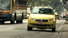 Street Level View Of A Waiting Taxi As Heavy Traffic Zooms By Stock Footage
