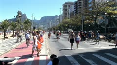 Crowds of People Jogging and Walking On the Beach In Rio De Janeiro, Brazil 4 Stock Footage