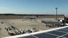 Solar panels at Narita Airport (plane takes off) Stock Footage