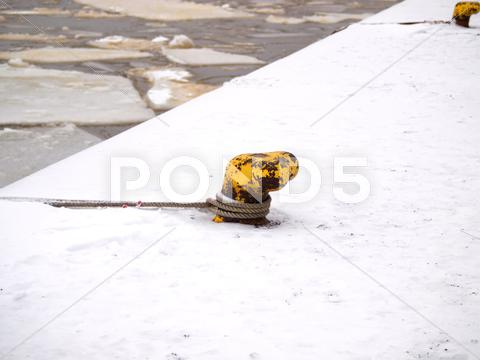 Stock photo of bollard and mooring lines