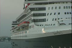 Queen Mary 2, ocean liner, leaving Port Everglades at sunset, close up - stock footage