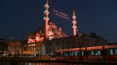 A tram passes in front of a mosque in istanbul, Turkey at night. Stock Footage