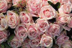 Pink roses in a wedding centerpiece Stock Photos