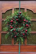 Christmas wreath on a glass door Stock Photos