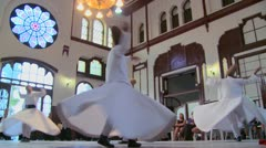 Whirling dervishes perform a mystical dance in Istanbul, Turkey. - stock footage