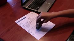 Stamping Invoice as Paid - stock footage