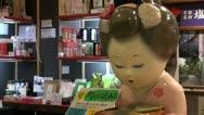 Geisha doll is nodding in a souvenir shop at Narita Airport, Tokyo Stock Footage