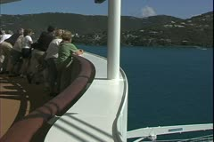 The Queen Mary 2, ocean liner, arriving in St. Thomas, people on the bow Stock Footage