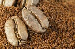 Stock Photo of coffee beans and ground coffee