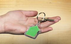 Keychain with figure of green house Stock Photos