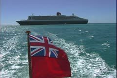 The Queen Mary 2, ocean liner, the tender speeds away from the ship - stock footage