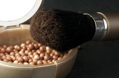 Make up brush and pearls Stock Photos