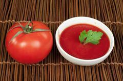 Stock Photo of tomato and bowl of tomato sauce
