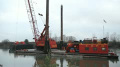 Dredger and Barge anchoring into position. Two shots. - stock footage
