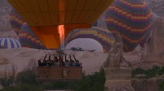 Hot air ballons rise from the desert floor in Cappadocia, Turkey. Stock Footage