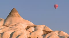 A hot air balloon with the Turkish flag flies over the magnificent geological - stock footage