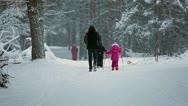 Granddad with grandchildren helping skiing Stock Footage