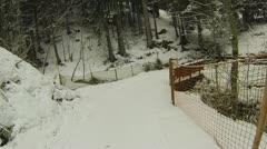 Actioncam: snowboarding through a snow lane Stock Footage