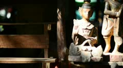 Tracked shots of wooden asian religious dolls Stock Footage