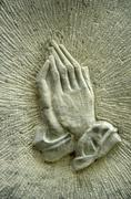 Praying hands Stock Photos