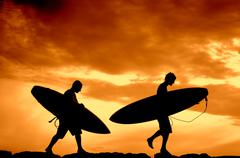 Sunset Surfers Stock Photos