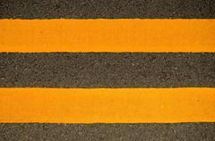 double yellow lines - stock photo