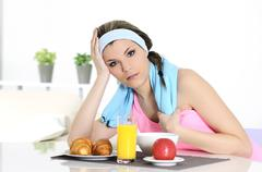 sportive woman having breakfast - stock photo
