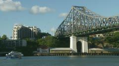 Small ferry under Brisbane bridge Stock Footage
