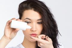 Stock Photo of young woman with contact lense