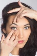 young woman with contact lense - stock photo