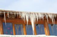 Big icicles in a cold day Stock Photos