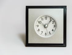 Alarm clock, square shape with rounded dial Stock Photos