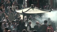 Crowds gather around urn that burns incense in Tokyo, Japan Stock Footage